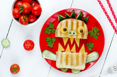 Delicious sandwich like a monster for kids party. Fun school lun Royalty Free Stock Photos