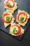 Delicious sandwich with prosciutto ham, cheese, tomato and egg Royalty Free Stock Photography