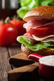 Delicious sandwich with prosciutto ham, cheese and vegetables Royalty Free Stock Photography