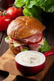 Delicious sandwich with prosciutto ham, cheese and vegetables Royalty Free Stock Photo