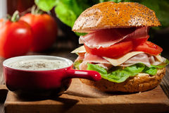 Delicious sandwich with prosciutto ham, cheese and vegetables Stock Photography
