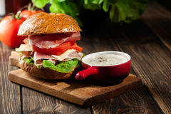 Delicious sandwich with prosciutto ham, cheese and vegetables Stock Images