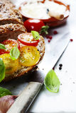 Delicious sandwich with slices of tomatoes and basil Royalty Free Stock Photos