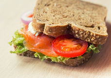Sandwich with smoked salmon. Delicious sandwich with smoked salmon Stock Images