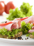 Delicious sandwich & tomatoes and lettuce Stock Photos