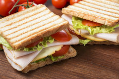 Delicious sandwiches. Sandwiches with chicken breast, salad, cheese and tomatoes stock photos