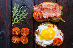 Delicious sandwiches close with roasted tomatoes and arugula Royalty Free Stock Photo