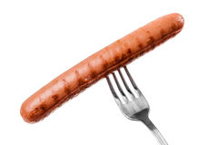 Sausage on a fork Stock Photos