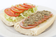 Delicious sausage sandwich with salad Stock Image