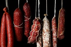 Delicious sausages hanging on background stock photography