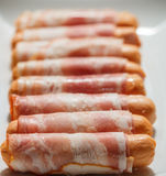 Delicious Sausages wrapped in bacon ready for roasting Royalty Free Stock Photos