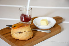 Delicious scone with butter and strawberry jam Stock Image