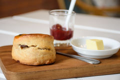 Delicious scone with butter and strawberry jam Stock Photos
