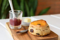Delicious scone with butter and strawberry jam Royalty Free Stock Photo