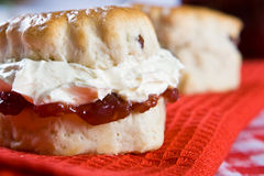 A delicious scone with clotted cream and jam Royalty Free Stock Photo