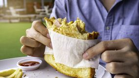 Delicious scrambled eggs ham cheese sandwich royalty free stock image