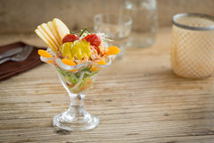 Delicious seafood appetizer served with apple and mandarin Stock Images