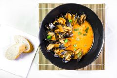 Delicious seafood mussels with red sauce and green onions royalty free stock photo