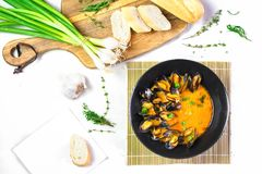 Delicious seafood mussels with red sauce and green onions stock image