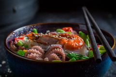 Delicious seafood noodle with octopus and shrimps Royalty Free Stock Photo