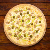 Delicious seafood pizza with olives Stock Photography
