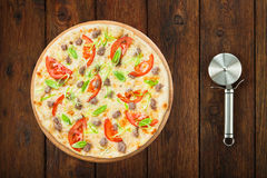 Delicious seafood pizza with tomatoes and cutter Stock Images