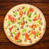 Delicious seafood pizza with tomatoes Stock Photography