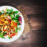 Delicious Seafood salad with vegetables and mussels on wooden ta Stock Photography