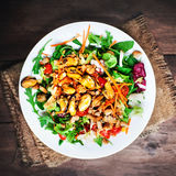 Delicious Seafood salad with vegetables and mussels on wooden ta Royalty Free Stock Photos