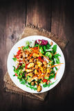 Delicious Seafood salad with vegetables and mussels on wooden ta Stock Photo