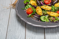 Delicious Seafood salad with vegetables and mussels on wooden table in rustic style Stock Images