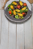 Delicious Seafood salad with vegetables and mussels on wooden table in rustic style Stock Photos
