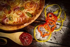Delicious seafood shrimps and mussels pizza on a black wooden table. Italian food. Top view royalty free stock photos