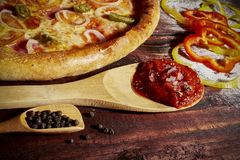 Delicious seafood shrimps and mussels pizza on a black wooden table. Italian food. Top view royalty free stock photography
