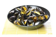 Delicious seafood steamed mussels on a plate royalty free stock images