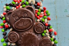 Delicious seasonal Sweets: chocolate figure bears and a lot of candy. The concept of Easter sweets. Sweets: chocolate figure bears and a lot of candy. The Royalty Free Stock Photography