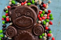 Delicious seasonal Sweets: chocolate figure bears and a lot of candy. The concept of Easter sweets. Sweets: chocolate figure bears and a lot of candy. The stock photo