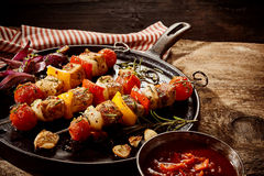 Delicious seasoned kebabs and chili sauce Royalty Free Stock Photos