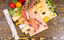 Delicious selection of cheese and spicy sausage Royalty Free Stock Photos