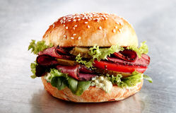 Delicious sesame bun with roast beef or pastrami Stock Images