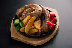 Delicious set of Bavarian sausages, thin beef sausages and fried stock photo