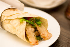 Delicious shawarma rolled sandwich with meat and vegetables Royalty Free Stock Image