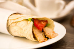 Delicious shawarma rolled sandwich with meat and vegetables Stock Photo