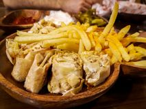Delicious shawarma on wooden background - Eastern food and fries stock image