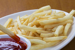 Delicious shoestring style french fries with ketchup Royalty Free Stock Photography