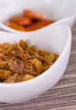 Delicious shredded chicken and shredded beef inside a white bowl over a wooden blackground.  stock image