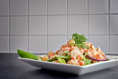 Delicious shrimp ceasar salad on a plate Stock Image