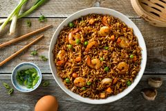 Shrimp Fried Rice. Delicious shrimp fried rice with egg, carrot, garlic, green peas and scallions royalty free stock photo