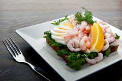 Delicious shrimp salad sandwich on a plate Stock Images