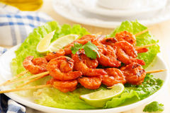 Delicious shrimp on skewers Stock Images